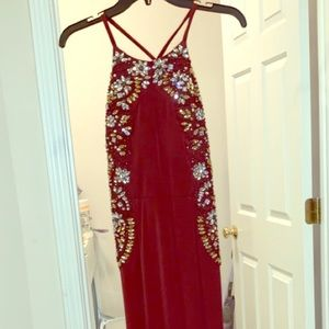 Maroon prom dress with golden and silver sequins